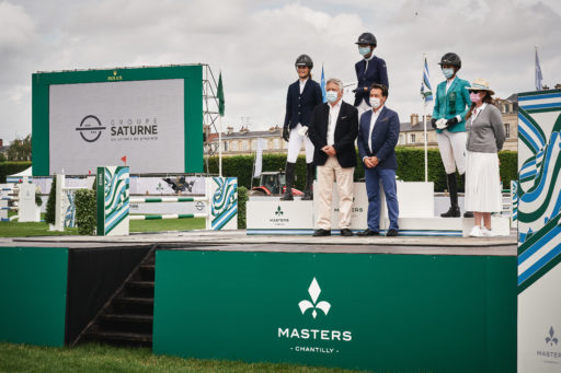 Isee Doem, Felicite Herzog and Annette Wolf are rewarded by officials on the podium of the Prix Groupe Saturne at the Masters of Chantilly, on July 09, 2021 in Chantilly, France. (Photo by Alexis Anice/ALeA/EEM)